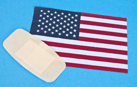 American Flag with Bandage for Concept of America Wounded. Stock Photo - 7065377