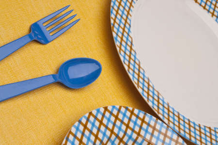 Modern Fun Blue and Brown Place Setting with a Vibrant Yellow Placemat. photo