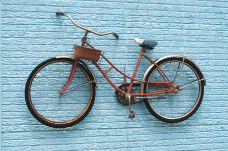 Vintage Bicycle on a Blue Brick Wall with a Basket.
