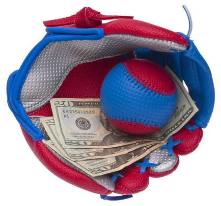 Youth  Sporting Gear with Money Represents the Cost of Youth Sports. Reklamní fotografie