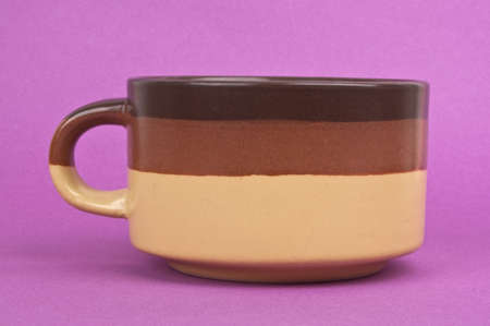 oversized: Oversized Mug for Soup on a Vibrant Purple Background.