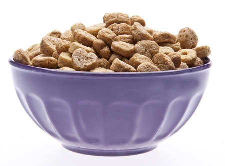 Breakfast Cereal with Heart Shapes in a Purple Bowl Isolated on White