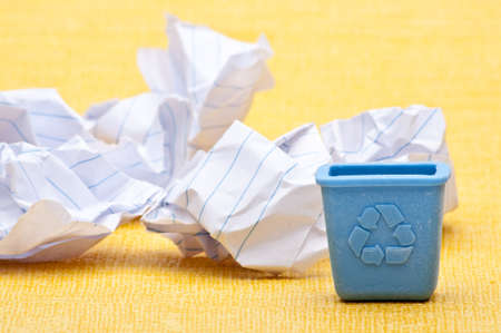 Recycle Concept with Blue Recycling Bin and Paper. Stock Photo