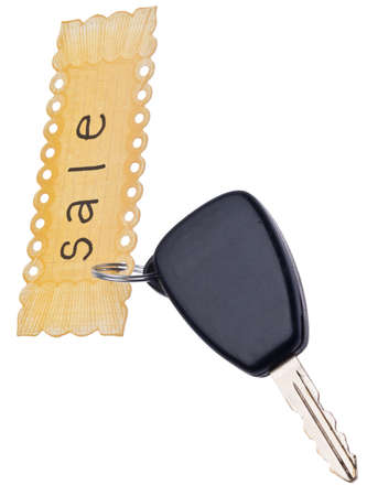 Car Sale Concept with Sale Tag and Automobile Key  photo
