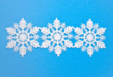 holidays: Snowflakes on Blue Background Image for Winter and Holiday Concepts.
