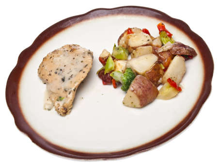 Healthy Portion Size of Chicken Dinner with Sauce, and a Side Dish of Vegetables and Potatoes.  Isolated on White. Stock Photo - 7373090