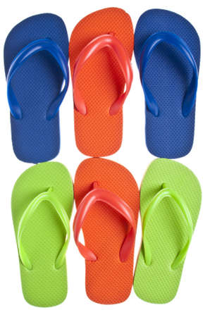 Vibrant Summer Flip Flops in Orange, Blue and Green. photo