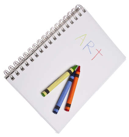 originative: The Word Art Written on a Pad with Several Vibrant Crayons Stock Photo