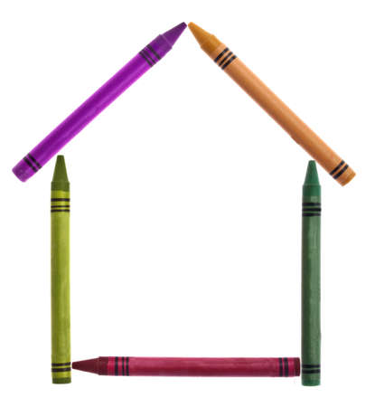 Vibrant Crayons in the Shape of a House for a Creative Home Concept