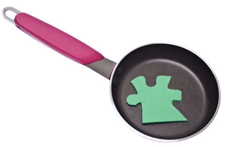originative: Puzzle Piece in a Kitchen Pan for a Creative Cooking Conceptual Image.
