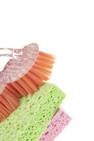 housecleaning: Housecleaning Border Featuring Sponges and a Scrub Brush Isolated on White