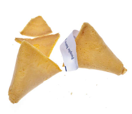 Fortune Cookie with Traditional Fortune Isolated on White  photo