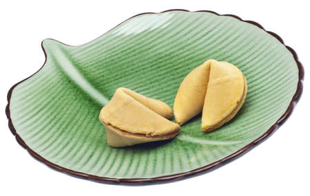 Pair of Fortune Cookies on a Green Plate Isolated on White  photo