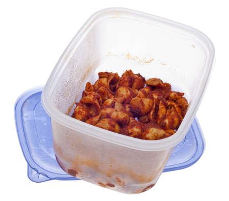 Shells and Red Sauce Pasta Leftovers in a Plastic Storage Container with Lid. photo