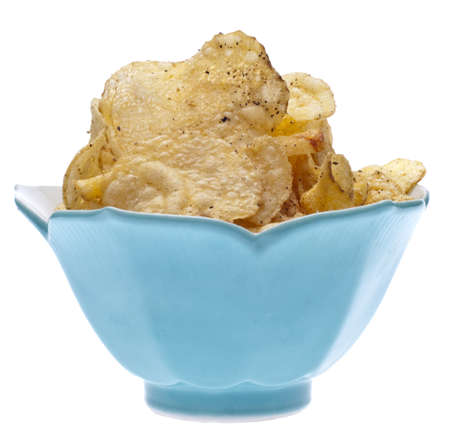 titbits: Salt and Pepper Potato Chips in a Blue Bowl Isolated on White.
