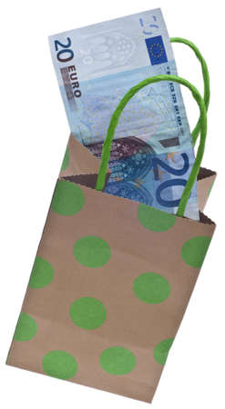 christmas budget: Money and a Gift Bag Symbolize a Gift Giving Budget Concept.