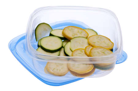 Leftover Squash and Zucchini in a Plastic Storage Container Isolated on White. photo