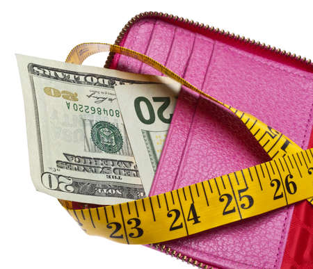 Tight Budget Concept with Open Wallet with Money Squeezed by a Measuring Tape. Stock Photo - 7747143