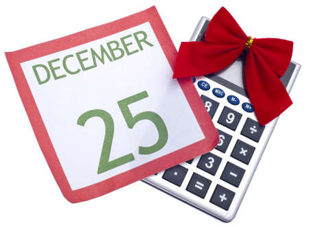 Calculator with Holiday Bow and Calendar Page Christmas Budget Concept. Standard-Bild