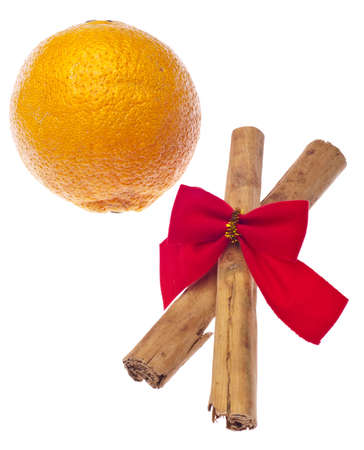 Holiday Cinnamon Sticks and an Orange Isolated on White