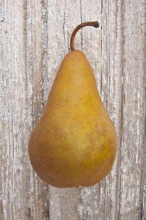 Single Pear on Vintage Wood Holiday Food Conceptual Image. photo