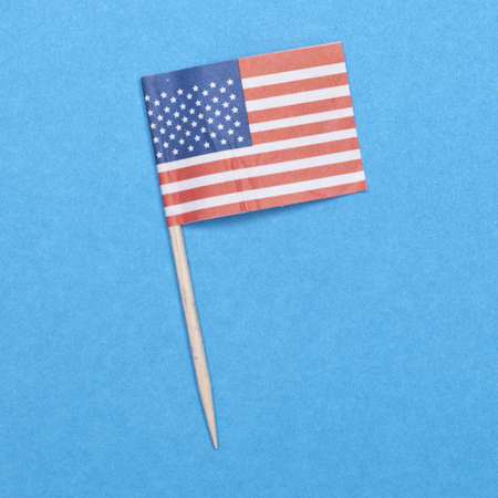 American Flag Toothpick on a Blue Background.  Everyday Object. photo