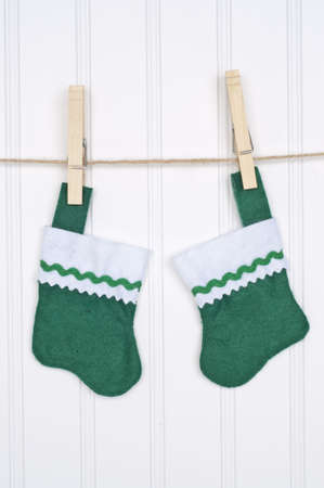 Holiday Stockings Hanging on a Clothesline on a White Background. photo