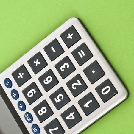 mundane: Close Up of a Calculator on a Vibrant Background.  Everyday Object Close Up.