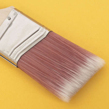 Close Up of a Paint Brush on a Vibrant Background.  Everyday Object Close Up. Stock Photo - 8135123