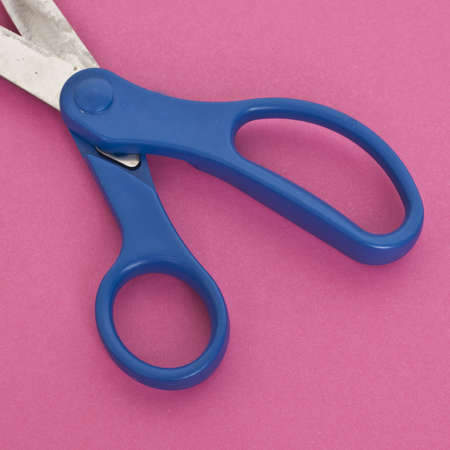 mundane: Close Up of Scissors on a Vibrant Background.  Everyday Object Close Up.