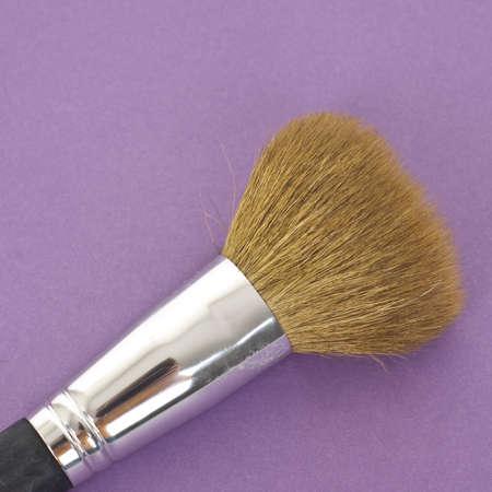 mundane: Close Up of Make Up Brush on a Vibrant Background