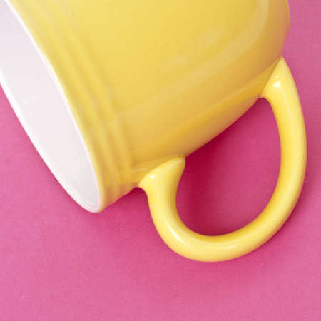 Yellow Coffee Cup with Focus on Handle on a Vibrant Background Stock Photo - 8135095