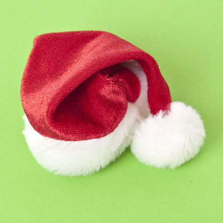 Holiday Santa Hat on a Vibrant Green Background. Stock Photo - 8135102