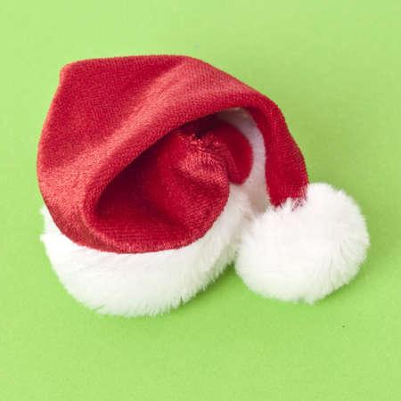 mundane: Holiday Santa Hat on a Vibrant Green Background.