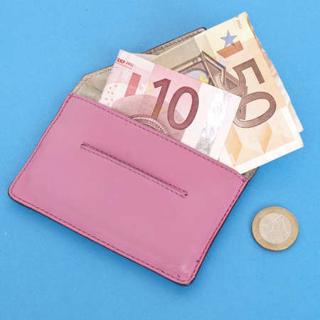 mundane: Wallet with Euro Currency on a Vibrant Blue Background.