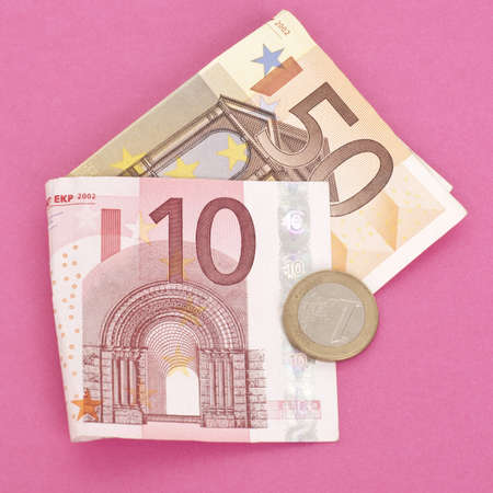 mundane: Euro Currency with a Modern Twist on a Hot Pink Background.