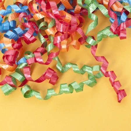 mundane: Party Ribbon on a Vibrant Orange Background.