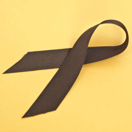 mundane: Brown Ribbon on Vibrant Yellow Symbolizes the Fight Against Tobacco and Colon Cancer.