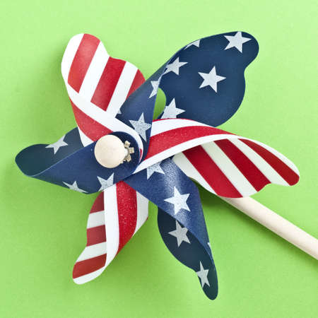 American Flag Patriotic Pinwheel on a Vibrant Green Background. photo