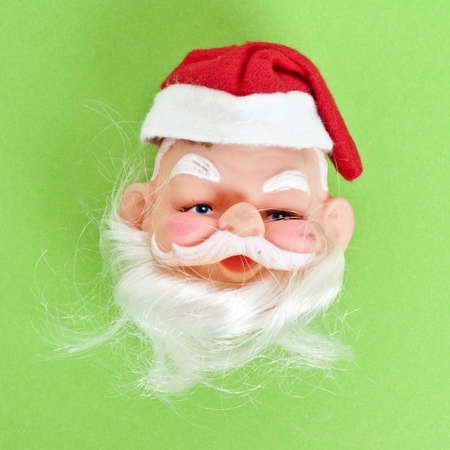 mundane: Vintage Santa Claus Figurine Face with Traditional Hat and Beard.