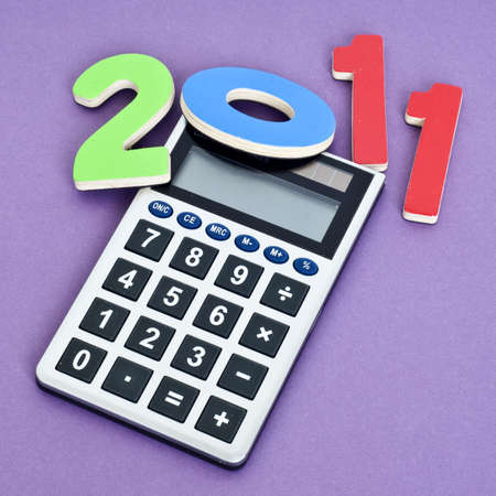mundane: Calculating 2011 Money Concept Image for the New Year. Stock Photo