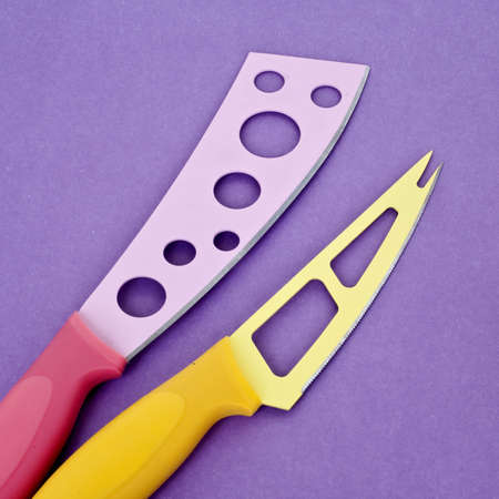 mundane: Set of Modern Kitchen Knives on a Vibrant Purple Background.