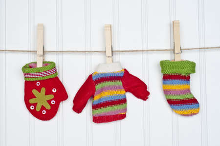 Mitten, Sweater and Warm Sock on a Clothesline.  Holiday Concept. photo