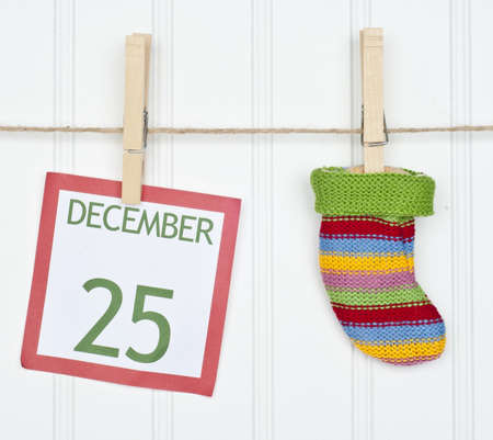 december 25: Holiday Stocking or Sock on a Clothesline with a Christmas Calendar Page.