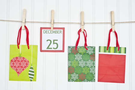 Gift Sack and Christmas Calendar Page on a Clothesline.  Holiday Concept. photo