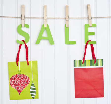 SALE and Holiday Gift Bags on a Clothesline.  Holiday Concept. photo