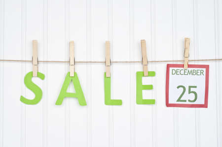 SALE on a Clothesline with a Christmas Calendar Page.  Holiday Concept. photo