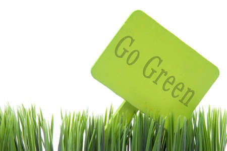 Go Green  sign in fresh grass isolated on a white background. Standard-Bild