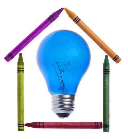 originative: Vibrant Crayons in the Shape of a House with a Light Bulb for a Creative Home Concept.  Isolated on White  Stock Photo