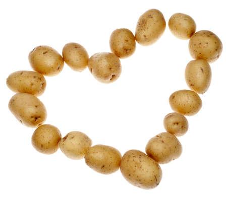 fingerling: White Artisan Fingerling Potatoes in a Heart Shape Isolated on White.